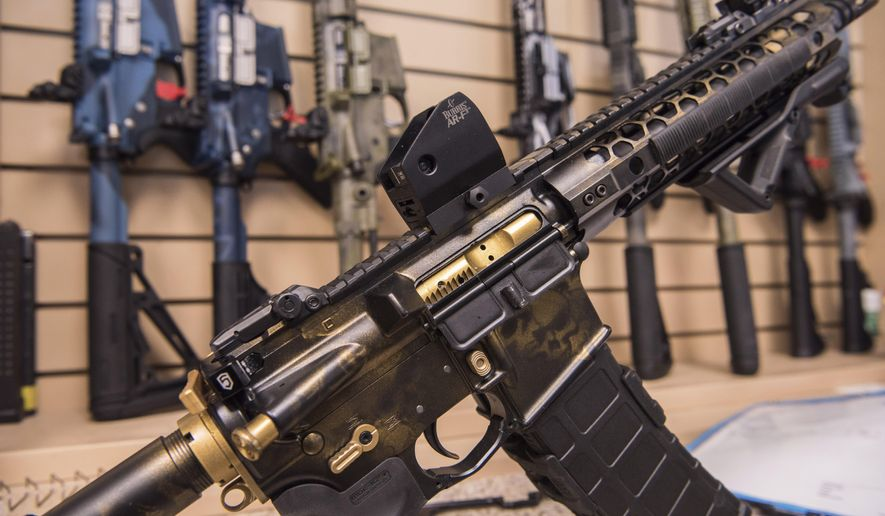 In this photo taken March 15, 2017, an AR-15 style  rifle manufactured by Battle Rifle Co. is display in Webster, Texas. Battle Rifle is one of now more than 10,000 gunmakers in the U.S. President Donald Trump promised to revive manufacturing in the U.S., but one sector is poised to shrink under his watch: the gun industry. Fears of limits on guns led to a surge in demand during President Barack Obama's tenure and manufacturers leapt to keep up. (AP Photo/Lisa Marie Pane)