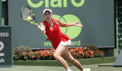 Caroline Wozniacki, of Denmark, returns a shot from Johanna Konta, of Britain, during the women's singles final tennis match at the Miami Open, Saturday, April 1, 2017 in Key Biscayne, Fla. (AP Photo/Wilfredo Lee)