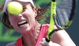 Johanna Konta, of Britain, returns a shot from Caroline Wozniacki, of Denmark, during the women's singles final tennis match at the Miami Open, Saturday, April 1, 2017 in Key Biscayne, Fla. (AP Photo/Wilfredo Lee)