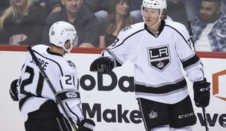 Los Angeles Kings' Tyler Toffoli, right, celebrates his goal with teammate Nick Shore during second period of an NHL hockey game against the Vancouver Canucks, in Vancouver, British Columbia, Friday, March 31, 2017. (Darryl Dyck/The Canadian Press via AP)