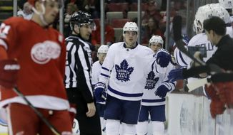 Toronto Maple Leafs center Auston Matthews greets teammates after scoring during the second period of the team's NHL hockey game against the Detroit Red Wings, Saturday, April 1, 2017, in Detroit. (AP Photo/Carlos Osorio)