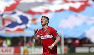 Chicago Fire midfielder Bastian Schweinsteiger (31) celebrates after scoring a goal in the first half of an MLS  soccer game against the Montreal Impact at Toyota Park in Bridgeview, Ill., Saturday, April 1, 2017. (Chris Sweda/Chicago Tribune via AP)