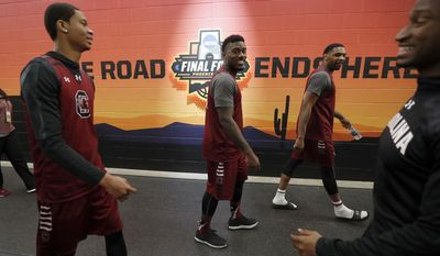 South Carolina players walk to the court for a practice session for their NCAA Final Four tournament college basketball semifinal game Friday, March 31, 2017, in Glendale, Ariz. (AP Photo/Charlie Neibergall)