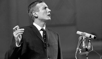 FILE - In this Dec. 28, 1962 file photo, anti-Stalinist poet Yevgenny Yevtushenko speaks during a reading of his poetry in Moscow's Tschaikovsky Concert Hall in Moscow. Yevtushenko, whose work focused on war atrocities and denounced anti-Semitism and tyrannical dictators, has died. He was 84, according to several Russian news outlets on Saturday, April 1, 2017. (AP Photo)