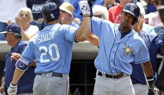 Tampa Bay Rays' Tim Beckham, right, gives Steven Souza Jr. (20) a fist bump after Souza hit a home run in the second inning a spring training baseball game against the Philadelphia Phillies, Friday, March 31, 2017, in Clearwater, Fla. (AP Photo/John Raoux)
