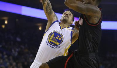 Houston Rockets' Trevor Ariza, right, shoots against Golden State Warriors' Matt Barnes (22) during the first half of an NBA basketball game Friday, March 31, 2017, in Oakland, Calif. (AP Photo/Ben Margot)