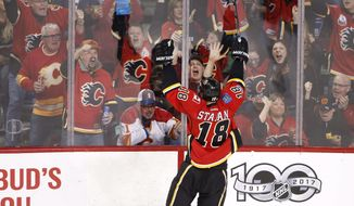 Calgary Flames' Matt Stajan celebrates with the crowd after his goal against the San Jose Sharks during the second period of an NHL hockey game Friday, March 31, 2017, in Calgary, Alberta. (Larry MacDougal/The Canadian Press via AP)