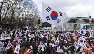 Supporters of former President Park Geun-hye hold national flags during a rally at downtown Seoul, South Korea, Saturday, April 1, 2017. Thousands of supporters of arrested former President Park gather in South Korea's capital on Saturday to call for her release. (AP Photo/Lee Jin-man)