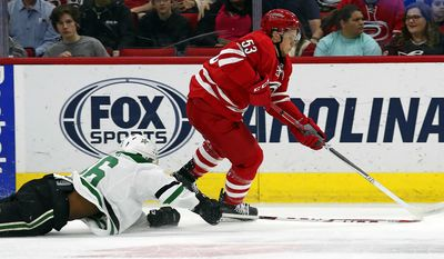 Carolina Hurricanes' Jeff Skinner (53) breaks away from Dallas Stars' Gemel Smith (46) during the first period of an NHL hockey game, Saturday, April 1, 2017, in Raleigh, N.C. (AP Photo/Karl B DeBlaker)