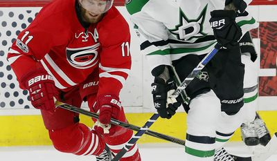Dallas Stars' Tyler Seguin (91) takes the puck away from Carolina Hurricanes' Jordan Staal (11) during the first period of an NHL hockey game, Saturday, April 1, 2017, in Raleigh, N.C. (AP Photo/Karl B DeBlaker)