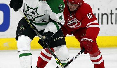 Dallas Stars' Remi Elie (40) battles with Carolina Hurricanes' Elias Lindholm (16) during the first period of an NHL hockey game, Saturday, April 1, 2017, in Raleigh, N.C. (AP Photo/Karl B DeBlaker)