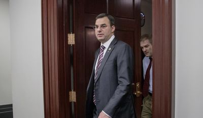 This March 28, 2017, photo shows Rep. Justin Amash, R-Mich., followed by Rep. Jim Jordan, R-Ohio, leaving a closed-door strategy session with Speaker of the House Paul Ryan, R-Wis. (Associated Press) *FILE**
