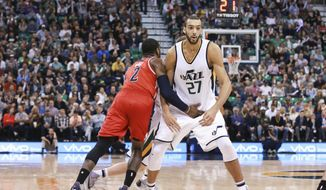 Washington Wizards guard John Wall (2) is called for a technical foul for hitting Utah Jazz center Rudy Gobert (27) as he runs past during the third quarter of NBA basketball game Friday, March 31, 2017, in Salt Lake City. The Utah Jazz won the game 95-88. (AP Photo/Chris Nicoll)
