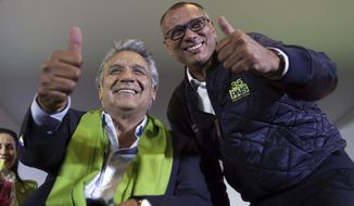 Alianza PAIS's presidential candidate Lenin Moreno (left) and his running mate Jorge Glas smile at the end of the day of the presidential election on Sunday. (Associated Press)