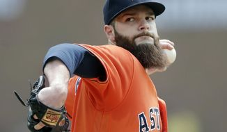 FILE - In this July 31, 2016, file photo, Houston Astros starting pitcher Dallas Keuchel throws during the first inning of a baseball game against the Detroit Tigers in Detroit. The Astros are confident their offense will be powerful enough to contend for a title. The question is if a rotation led by 2015 AL Cy Young winner Dallas Keuchel can bounce back a year after injuries and inconsistency kept the team from reaching the postseason.  (AP Photo/Carlos Osorio, File)