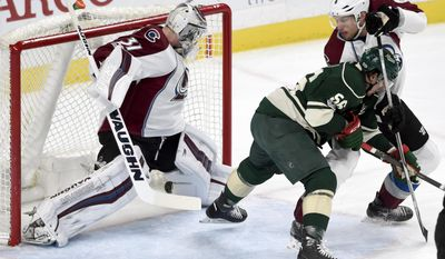 Colorado Avalanche goalie Calvin Pickard (31) allows a shot by Minnesota Wild defenseman Jared Spurgeon (not shown) to go into the net while Wild center Erik Haula (56), of Finland, and Colorado Avalanche defenseman Erik Johnson (6) watch during the first period of an NHL hockey game Sunday, April 2, 2017, in St. Paul, Minn. (AP Photo/Hannah Foslien)