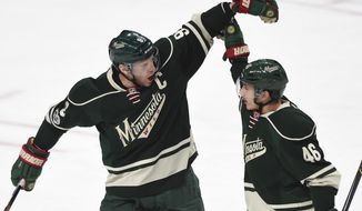 Minnesota Wild center Mikko Koivu (9), of Finland, congratulates defenseman Jared Spurgeon (46) on a goal against the Colorado Avalanche during the first period of an NHL hockey game Sunday, April 2, 2017, in St. Paul, Minn. (AP Photo/Hannah Foslien)