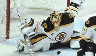 Boston Bruins goalie Anton Khudobin of Kazakhstan, makes a save during the first period of an NHL hockey game against the Chicago Blackhawks, Sunday, April 2, 2017, in Chicago. (AP Photo/Paul Beaty)