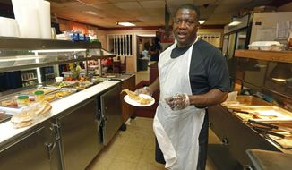 """In a Thursday, March 23, 2017 photo, Terry Waller, owner of The Lunch Basket, a Belzoni, Miss., restaurant, says that public television is important at his house, and recalls watching """"Sesame Street"""" as he grew up. Waller's three chldren, ages 4, 5 and 8, also enjoy watching the children's programing on the Public Broadcasting Service. (AP Photo/Rogelio V. Solis)"""