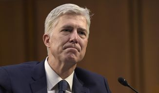 In this Wednesday, March 22, 2017, file photo, Supreme Court Justice nominee Neil Gorsuch listens as he is asked a question by Sen. Mazie Hirono, D-Hawaii, on Capitol Hill in Washington, during his confirmation hearing before the Senate Judiciary Committee. (AP Photo/Susan Walsh, File)