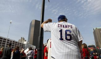 Chicago Cubs fan Bryan Rhodes leans against a post outside Busch Stadium before a baseball game between the St. Louis Cardinals and the Cubs on opening day Sunday, April 2, 2017, in St. Louis. (AP Photo/Jeff Roberson)