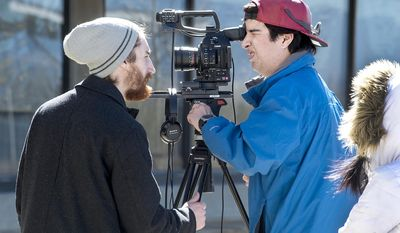 "Film director Josh Munson, left, checks a camera angle with cameraman Sam Torres during the filming of ""Black Coffee"" on the Colorado State University-Pueblo campus in Pueblo Colo., on March, 7, 2017. Munson and CSU-Pueblo philosophy professor Andrew Corsa worked with students to make a philosophy-based film. (John Jaques/The Pueblo Chieftain via AP)"