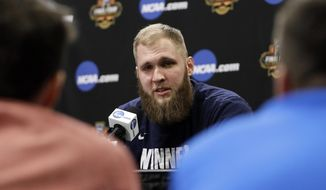 Gonzaga's Przemek Karnowski talks to reporters during a news conference for the Final Four NCAA college basketball tournament, Sunday, April 2, 2017, in Glendale, Ariz. (AP Photo/Mark Humphrey)