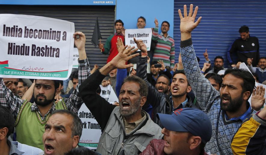 Supporters of Kashmir's Awami Ittihaad party shout slogans protesting against the visit of Indian Prime Minister Narendra Modi in Srinagar, Indian controlled Kashmir, Sunday, April 2, 2017. Kashmiri separatists called for a strike Sunday to protest against the visit of Indian Prime Minister Narendra Modi to the disputed region. (AP Photo/Mukhtar Khan)