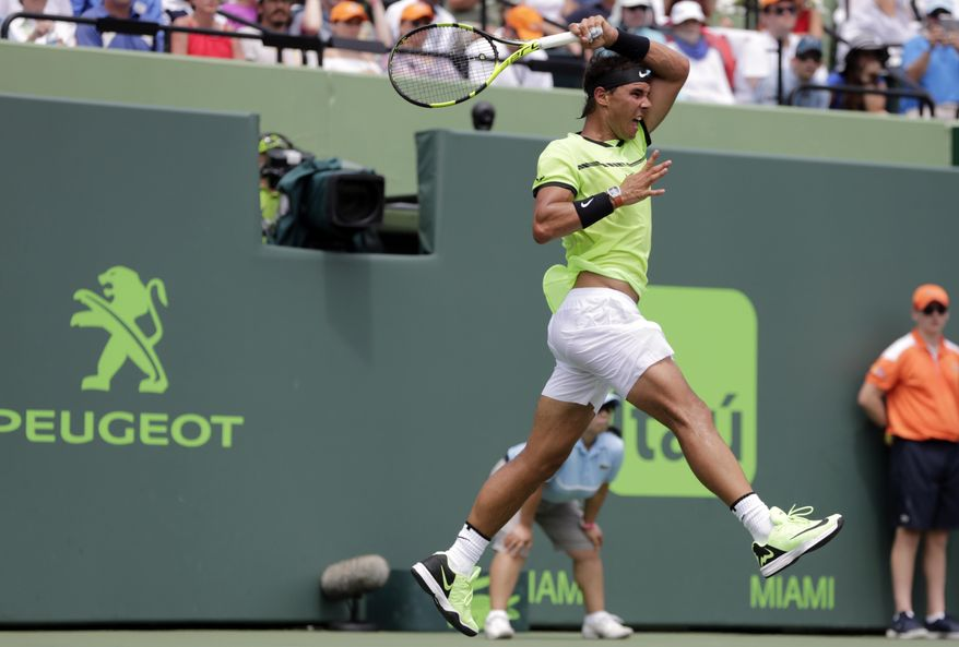 Rafael Nadal, of Spain, serves to Roger Federer, of Switzerland, during the men's singles final at the Miami Open tennis tournament, Sunday, April 2, 2017, in Key Biscayne, Fla. (AP Photo/Lynne Sladky)