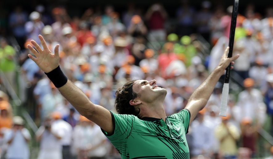 Roger Federer, of Switzerland, celebrates after defeating Rafael Nadal, of Spain, in the men's singles final at the Miami Open tennis tournament, Sunday, April 2, 2017, in Key Biscayne, Fla. (AP Photo/Lynne Sladky)