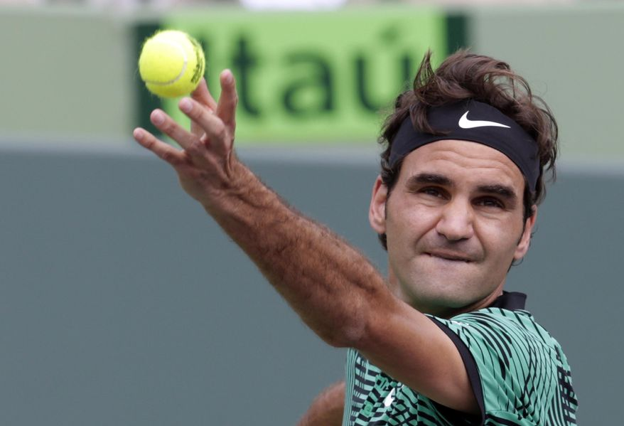 Roger Federer, of Switzerland, serves to Rafael Nadal, of Spain, during the men's singles final at the Miami Open tennis tournament, Sunday, April 2, 2017, in Key Biscayne, Fla. (AP Photo/Lynne Sladky)