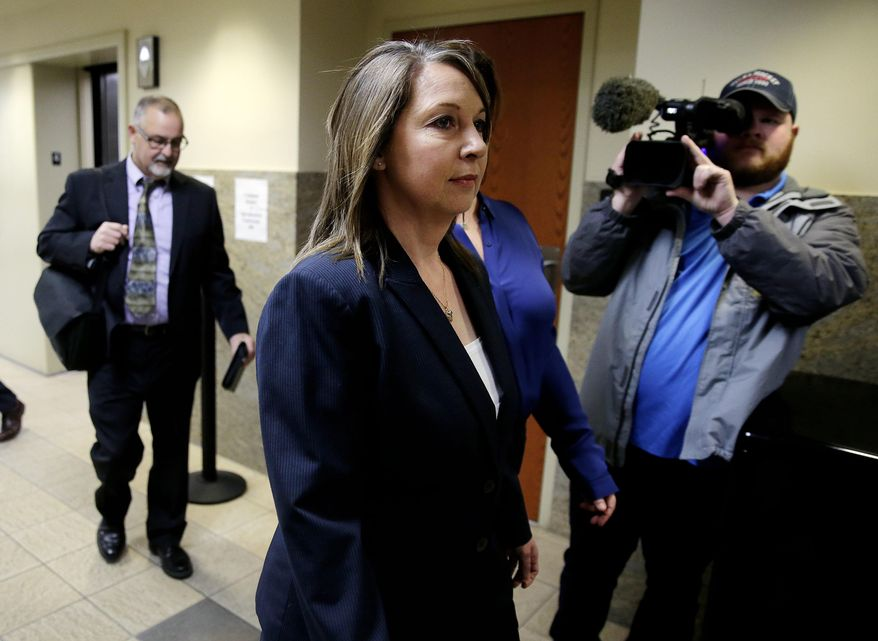"""FILE - In a Wednesday, Feb. 1, 2017 file photo, Tulsa Police officer Betty Shelby arrives at the Tulsa County Courthouse for a hearing, in Tulsa, Okla. Shelby,  facing a manslaughter chargein the fatal shooting of Terence Crutcher, tells """"60 Minutes"""" in an episode set to air Sunday, April 2, that she used lethal force because she feared 40-year-old Crutcher was reaching inside his SUV for a gun. She has pleaded not guilty and goes to trial May 8. (Mike Simons/Tulsa World via AP, File)"""