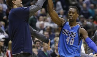 Dallas Mavericks' Harrison Barnes, right, celebrates with teammate Dirk Nowitzki during the second half of the team's NBA basketball game against the Milwaukee Bucks on Sunday, April 2, 2017, in Milwaukee. (AP Photo/Jeffrey Phelps)