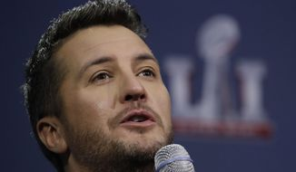 """FILE - In this Feb. 2, 2017 file photo, Luke Bryan answers questions at a news conference for the NFL Super Bowl 51 football game  in Houston.  The Academy of Country Music Awards will unite the democrats and republicans, according to the show's host, and part-time comedian, Luke Bryan.  """"Coming to an election near you. Is politics your next career?"""" chimed in fellow country singer Dierks Bentley, who will co-host the show with Bryan on Sunday, April 2, 2017. (AP Photo/Morry Gash)"""