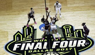 Mississippi State center Teaira McCowan (15) and South Carolina forward A'ja Wilson (22) reach for the ball on the opening tipoff of the final of the NCAA women's college basketball tournament Final Four, Sunday, April 2, 2017, in Dallas. (AP Photo/Eric Gay)