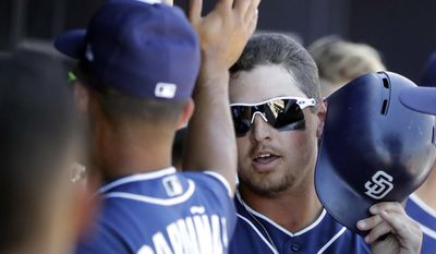 San Diego Padres' Hunter Renfroe is congratulated after scoring during the second inning of a spring training baseball game against the Colorado Rockies, Thursday, March 30, 2017, in Peoria, Ariz. (AP Photo/Darron Cummings)