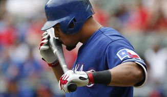 Texas Rangers designated hitter Carlos Gomez (14) kisses his bat before stepping to the plate against the Kansas City Royals during the second inning of an exhibition baseball game Saturday, April 1, 2017, in Arlington, Texas. (AP Photo/Michael Ainsworth)