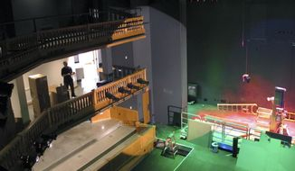 In this March 28, 2017 photo, crews install theater lighting and seating in the new Highland Center for the Arts in Greensboro, Vt. The $14 million facility, paid for by a summer resident, is set to open in early June. (AP Photo/Lisa Rathke)