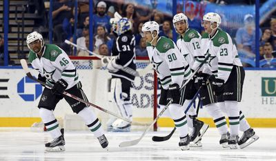 Dallas Stars, from left, Gemel Smith; Jason Spezza; Radek Faksa, of the Czech Republic; and Esa Lindell, of Finland, celebrate a goal as Tampa Bay Lightning goalie Peter Budaj, of Slovakia, reacts during the second period of an NHL hockey game Sunday, April 2, 2017, in Tampa, Fla. (AP Photo/Mike Carlson)
