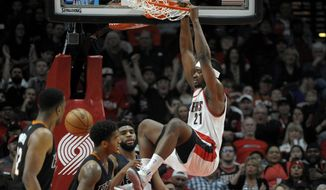 Portland Trail Blazers forward Noah Vonleh dunks during the first quarter of the team's NBA basketball game against the Phoenix Suns in Portland, Ore., Saturday, April 1, 2017. (AP Photo/Steve Dykes)