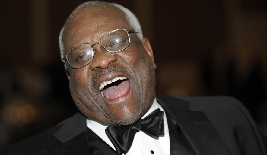 Supreme Court Justice Clarence Thomas appears in an exhibit that was installed Sunday in the Smithsonian's National Museum of African American History and Culture. The display honors both of the black justices who ascended to the pinnacle of the legal profession. The other is Thurgood Marshall. (Associated Press/File)