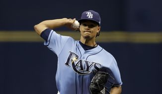 Tampa Bay Rays starting pitcher Chris Archer throws the first pitch of the season during the first inning of a baseball game against the New York Yankees, Sunday, April 2, 2017, in St. Petersburg, Fla. (AP Photo/Chris O'Meara)