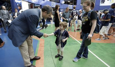 Tampa Bay Rays owner Stuart Sternberg, left, shakes hands with fans entering Tropicana Field before an Opening Day baseball game between the Rays and the New York Yankees, Sunday, April 2, 2017, in St. Petersburg, Fla. (AP Photo/Chris O'Meara)