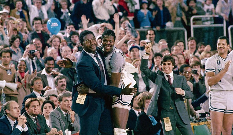 FILE - In this April 2, 1984, file photo, Georgetown head coach John Thompson, left, gives a happy pat to the most valuable player Patrick Ewing, after Georgetown defeated the Houston Cougars, 84-75, in an NCAA playoff game in Seattle. (AP Photo/File) **FILE**