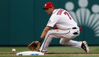Washington Nationals shortstop Trea Turner fields a ground ball before throwing to first base for the out on Miami Marlins' Derek Dietrich, during the third inning of an opening day baseball game at Nationals Park, Monday, April 3, 2017, in Washington. (AP Photo/Alex Brandon)