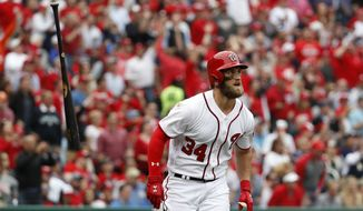 Washington Nationals' Bryce Harper flips his bat as he watches his solo home run during the sixth inning of an opening day baseball game against the Miami Marlins, at Nationals Park, Monday, April 3, 2017, in Washington. (AP Photo/Alex Brandon)