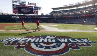 Members of the grounds crew spray the field before an opening day baseball game between the Washington Nationals and the Miami Marlins at Nationals Park, Monday, April 3, 2017, in Washington. (AP Photo/Alex Brandon) **FILE**