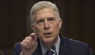 Supreme Court Justice nominee Neil Gorsuch is at the center of a partisan battle. Republicans are likely to change Senate rules to confirm him. (Associated Press/File)