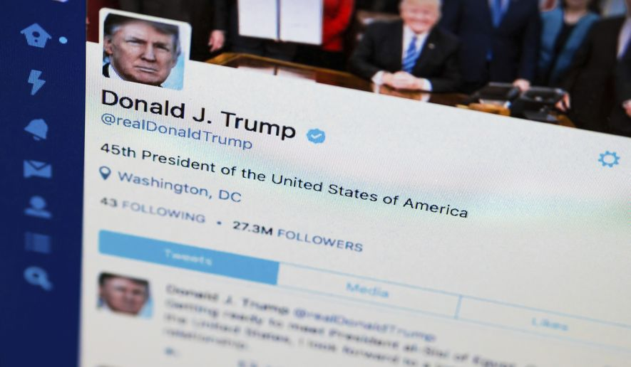 President Donald Trump's Twitter feed is photographed on a computer screen in Washington, Monday. April 3, 2017. The National Archives is telling the White House to keep each of President Donald Trump's tweets, even those he deletes or corrects. (AP Photo/J. David Ake)