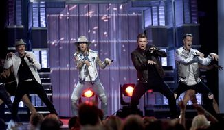 Brian Littrell, left, and Nick Carter, second from right, of Backstreet Boys, and Brian Kelley, second left, and Tyler Hubbard, right, of Florida Georgia Line, perform at the 52nd annual Academy of Country Music Awards at the T-Mobile Arena on Sunday, April 2, 2017, in Las Vegas. (Photo by Chris Pizzello/Invision/AP)
